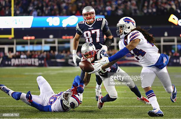 Stephon Gilmore of the Buffalo Bills intercepts a pass intended for Chris Harper of the New England Patriots during the fourth quarter at Gillette...