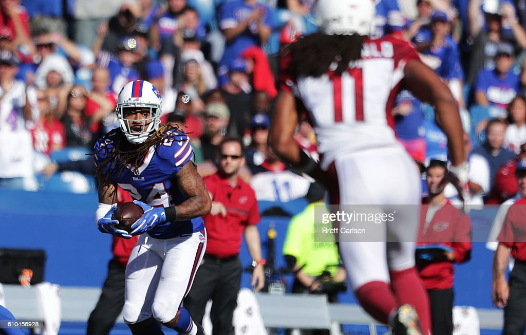 Stephon Gilmore #24 of the Buffalo Bills returns an inteception against the Arizona Cardinals during the second half at New Era Field on September 25, 2016 in Orchard Park, New York.