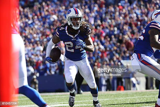 Stephon Gilmore of the Buffalo Bills returns an inteception against the Arizona Cardinals during the second half at New Era Field on September 25...