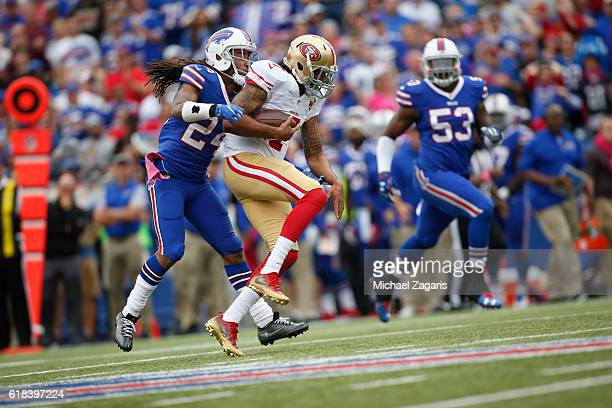 Stephon Gilmore of the Buffalo Bills tackles Colin Kaepernick of the San Francisco 49ers during the game at New Era Field on October 16 2016 in...