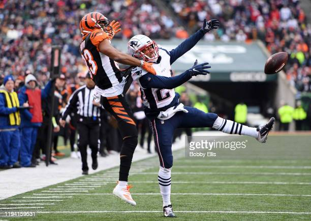 Stephon Gilmore of the New England Patriots breaks up a pass intended for Tyler Boyd of the Cincinnati Bengals during the second half in the game at...