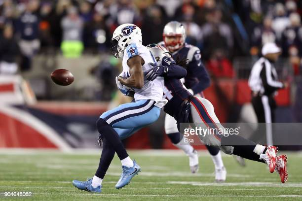 Stephon Gilmore of the New England Patriots breaks up a pass intended for Corey Davis of the Tennessee Titans in the second quarter of the AFC...