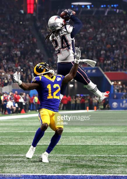 Stephon Gilmore of the New England Patriots catches a fourth quarter interception on a pass intended for Brandin Cooks of the Los Angeles Rams during...