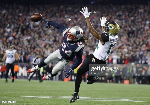 Stephon Gilmore of the New England Patriots deflects a pass intended for Dede Westbrook of the Jacksonville Jaguars in the fouorth quarter during the...