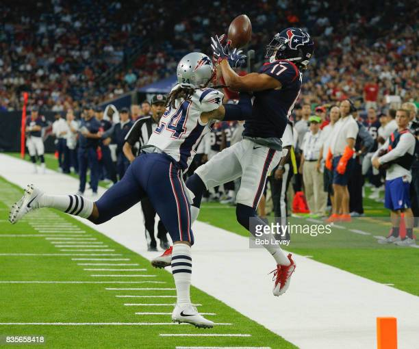 Stephon Gilmore of the New England Patriots disrupts a pass intended for Dres Anderson of the Houston Texans in the first half at NRG Stadium on...