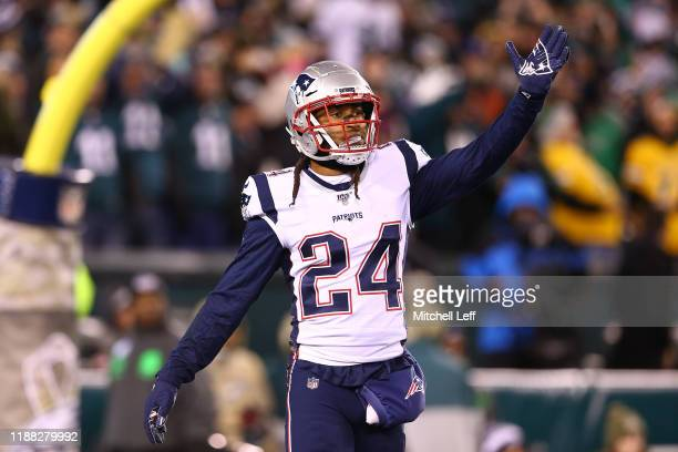 Stephon Gilmore of the New England Patriots gestures during the first half against the Philadelphia Eagles at Lincoln Financial Field on November 17...