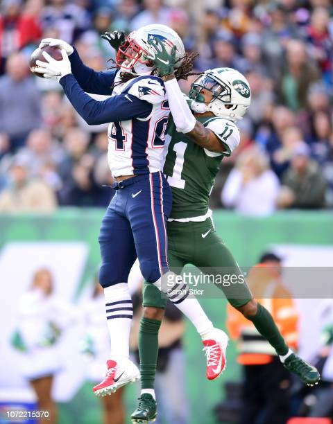 Stephon Gilmore of the New England Patriots intercepts a pass intended for Robby Anderson of the New York Jets during the second quarter at MetLife...