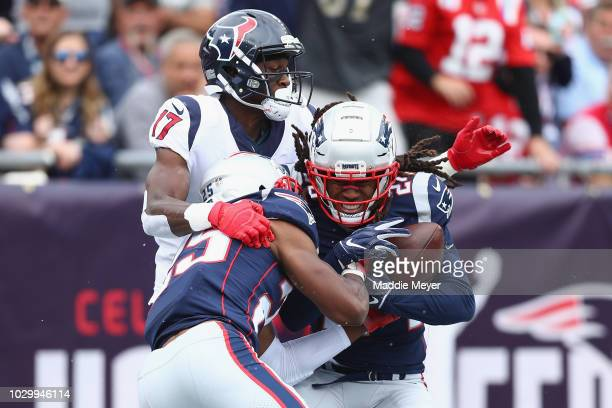 Stephon Gilmore of the New England Patriots intercepts a pass thrown by Deshaun Watson of the Houston Texans in the end zone during the second...