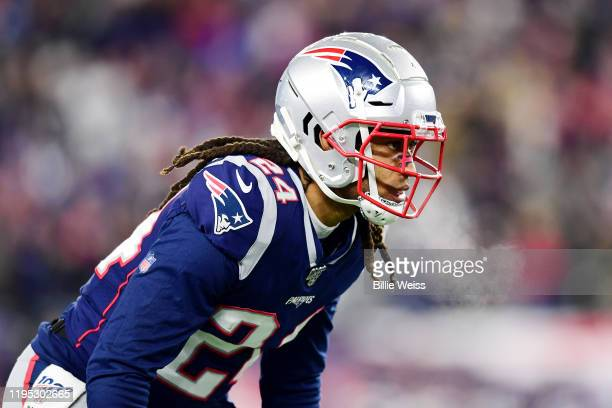 Stephon Gilmore of the New England Patriots looks on during the first half against the Buffalo Bills in the game at Gillette Stadium on December 21...