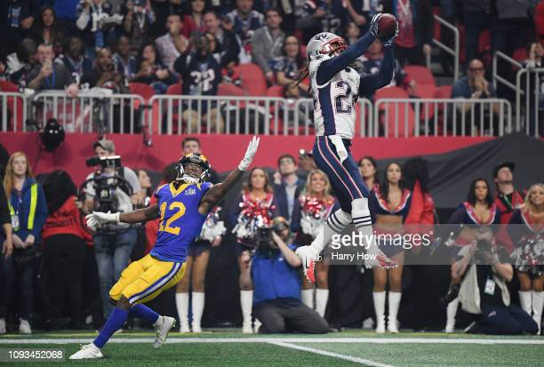 Stephon Gilmore of the New England Patriots makes an interception in the fourth quarter during Super Bowl LIII against the Los Angeles Rams at...