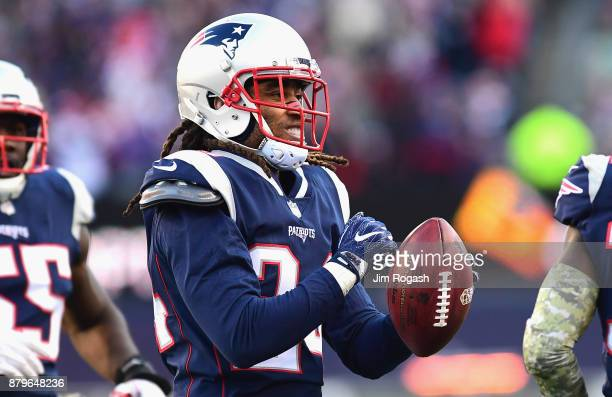Stephon Gilmore of the New England Patriots reacts after intercepting a pass during the second quarter of a game against the Miami Dolphins at...