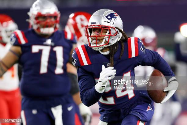Stephon Gilmore of the New England Patriots runs the ball after recovering a fumble against the Kansas City Chiefs at Gillette Stadium on December 08...