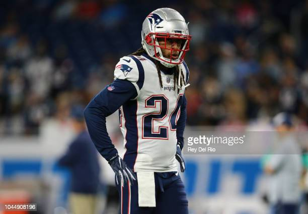 Stephon Gilmore of the New England Patriots warms up prior to the start of the game against the Detroit Lions at Ford Field on September 23 2018 in...