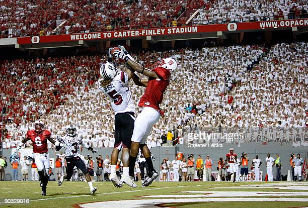 Stephon Gilmore of the South Carolina Gamecocks knocks down the ball against Jarvis Williams of the North Carolina State Wolfpack that seal a 73...