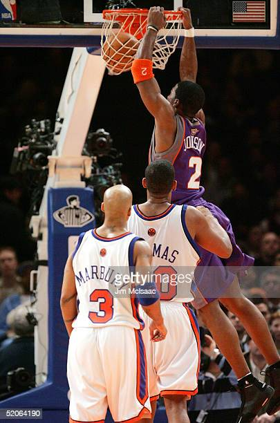 Stephon Marbury and Kurt Thomas of the New York Knicks can only watch as Joe Johnson of the Phoenix Suns dunks a basket on January 25 2005 at Madison...