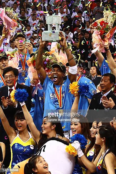 Stephon Marbury of the Beijing Ducks holds up the trophy after winning Game 5 the 2012 CBA Championship Finals against the Guangdong Southern Tigers...