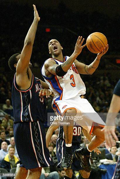 Stephon Marbury of the New York Knicks drives against Jason Collins #of the New Jersey Nets on April 25, 2004 in Game four of the Eastern Conference...