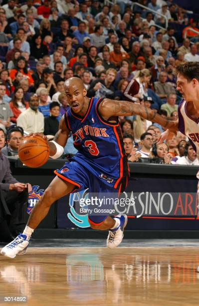 Stephon Marbury of the New York Knicks drives against the Phoenix Suns on February 25 2004 at America West Arena in Phoenix Arizona NOTE TO USER User...
