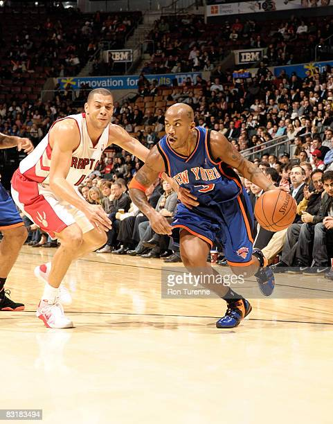 Stephon Marbury of the New York Knicks drives past Anthony Parker of the Toronto Raptors on October 8th 2008 at the Air Canada Centre in Toronto...