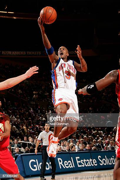 Stephon Marbury of the New York Knicks drives to the basket for a layup during a game against the Atlanta Hawks at Madison Square Garden on March 15...