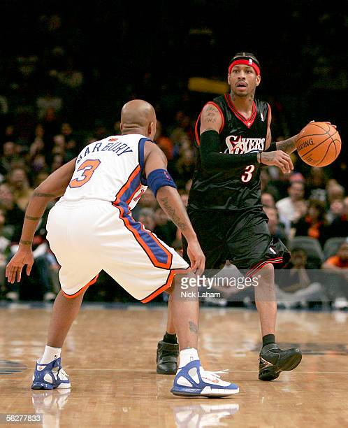 Stephon Marbury of the New York Knicks guards Allen Iverson of the Philadelphia 76ers on November 26 2005 at Madison Square Garden in New York City...