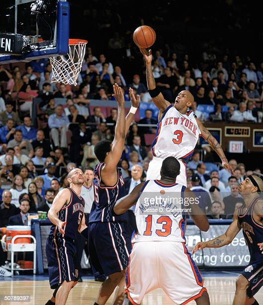 Stephon Marbury of the New York Knicks lays the ball up over Jason Collins of the New Jersey Nets during game three of the opening round of the 2004...