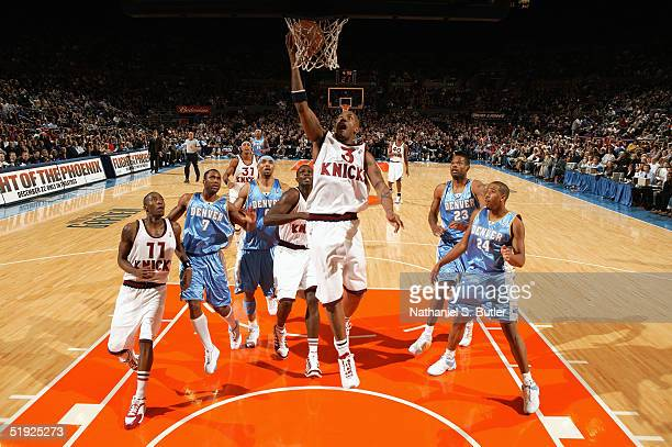 Stephon Marbury of the New York Knicks shoots a layup against the Denver Nuggets during the game at Madison Square Garden on December 12 2004 in New...