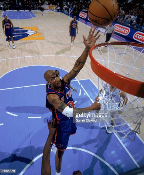 Stephon Marbury of the New York Knicks shoots a layup during the game against the Denver Nuggets at Pepsi Center on February 29 2004 in Denver...