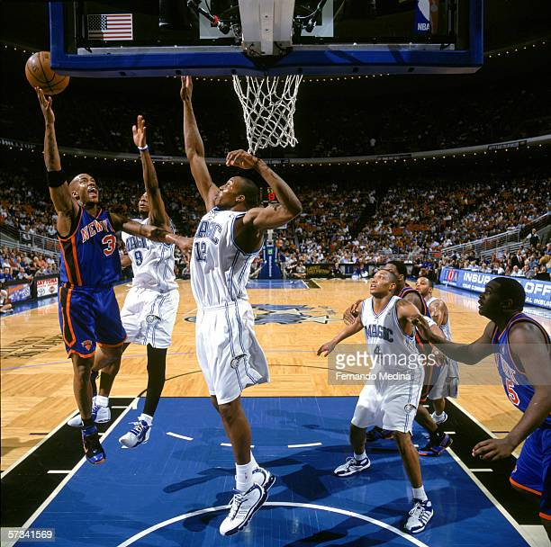 Stephon Marbury of the New York Knicks shoots against DeShawn Stevenson and Dwight Howard of the Orlando Magic during the game at the TD Waterhouse...