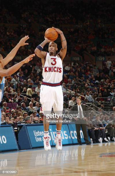 Stephon Marbury of the New York Knicks shoots against the Denver Nuggets during the game at Madison Square Garden on December 12 2004 in New York New...