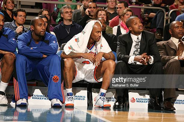 Stephon Marbury of the New York Knicks sits on the bench between Mardy Collins and Steve Francis during the NBA game against the Milwaukee Bucks on...