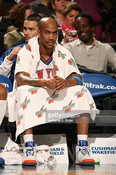 Stephon Marbury of the New York Knicks sits on the bench during the NBA game against the Milwaukee Bucks on December 9 2006 at Madison Square Garden...