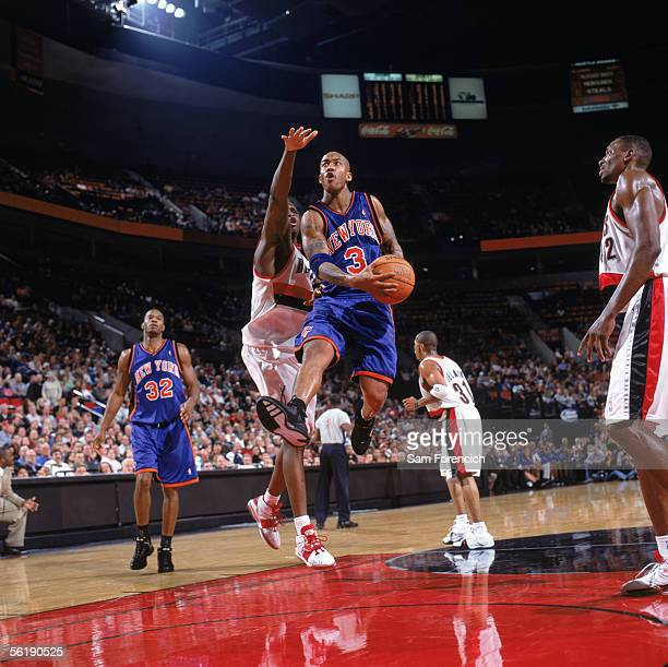 Stephon Marbury of the New York Knicks takes the ball to the basket past Zach Randolph of the Portland Trail Blazers during a game at The Rose Garden...