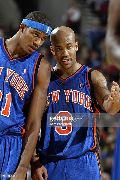 Stephon Marbury of the New York Knicks talks with Trevor Ariza during the game against the Portland Trail Blazers on November 9 2005 at the Rose...