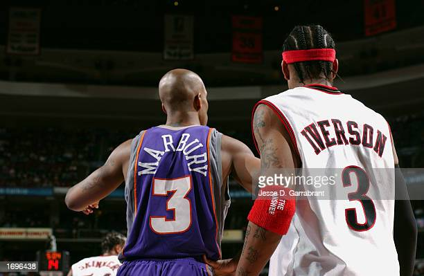 Stephon Marbury of the Phoenix Suns and Allen Iverson of the Philadelphia 76ers stand on the court during the game at First Union Center on December...