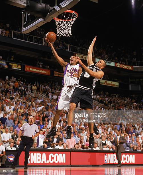 Stephon Marbury of the Phoenix Suns goes up with the ball against Tony Parker of the San Antonio Spurs in Game Four of the Western Conference...