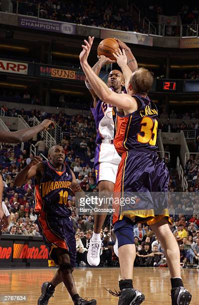 Stephon Marbury of the Phoenix Suns shoots against the Dallas Mavericks at America West Arena on November 28 2003 in Phoenix Arizona NOTE TO USER...