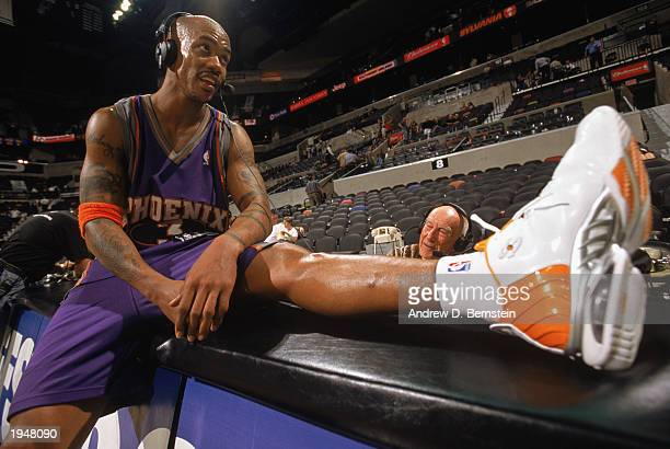 Stephon Marbury of the Phoenix Suns sits on the scorer's table as he talks to the media after defeating the San Antonio Spurs in Game one of the...
