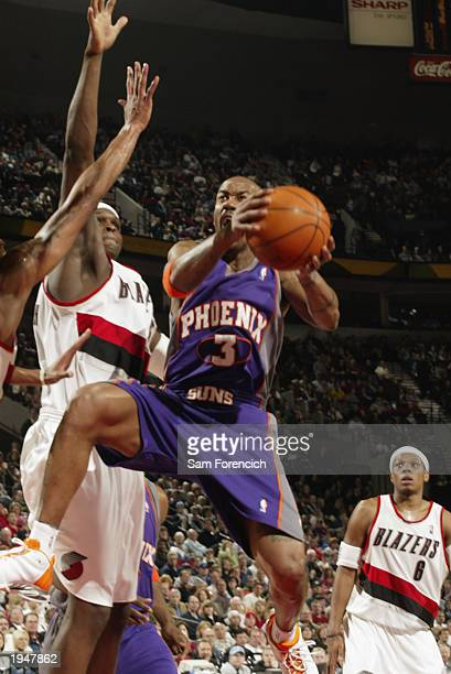 Stephon Marbury of the Phoenix Suns takes the ball to the basket against Zach Randolph of the Portland Trail Blazers during the game at The Rose...