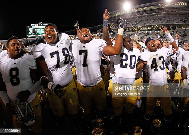 Stephon Tuitt Cierre Wood Ronnie Stanley Josh Atkinson and Kendall Moore of the Notre Dame Fighting Irish celebrate a 203 victory over the Michigan...