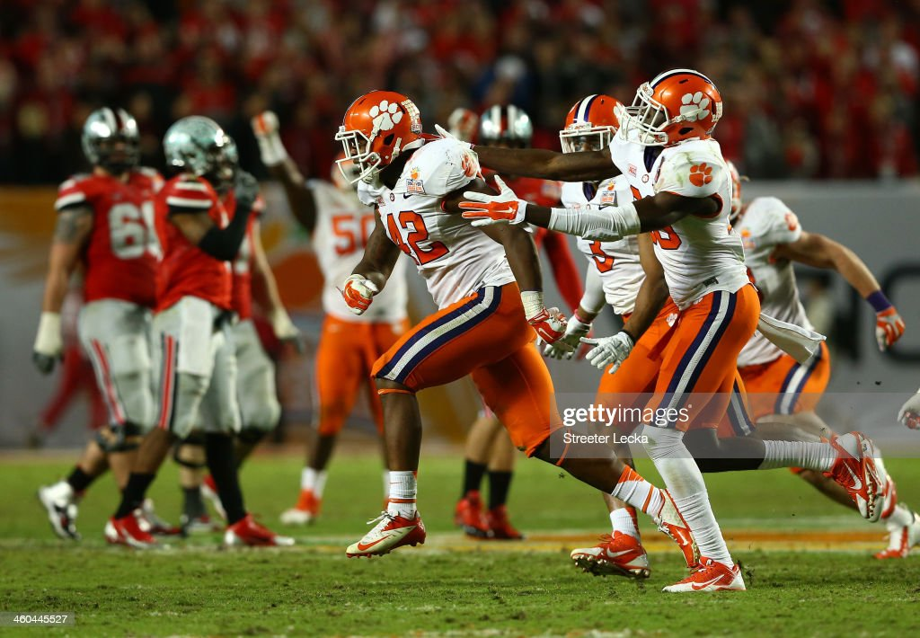 Stephone Anthony #42 of the Clemson Tigers celebrates with teammates after an interception late in the game against the Ohio State Buckeyes during the Discover Orange Bowl at Sun Life Stadium on January 3, 2014 in Miami Gardens, Florida.