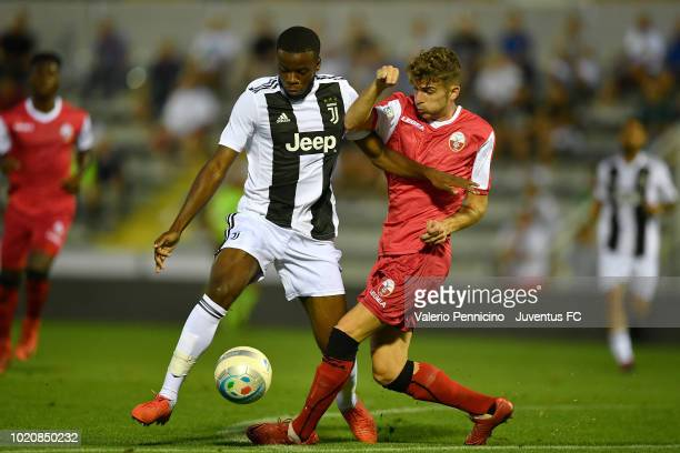 Stephy Alvaro Mavididi of Juventus U23 is challenged during the Coppa Italia Serie C match between Juventus U23 and Cuneo at Moccagatta Stadium on...