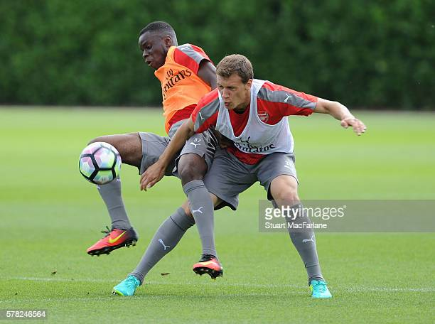 Stephy Mavididi and Krystian Bielik of Arsenal during a training session at London Colney on July 21, 2016 in St Albans, England.
