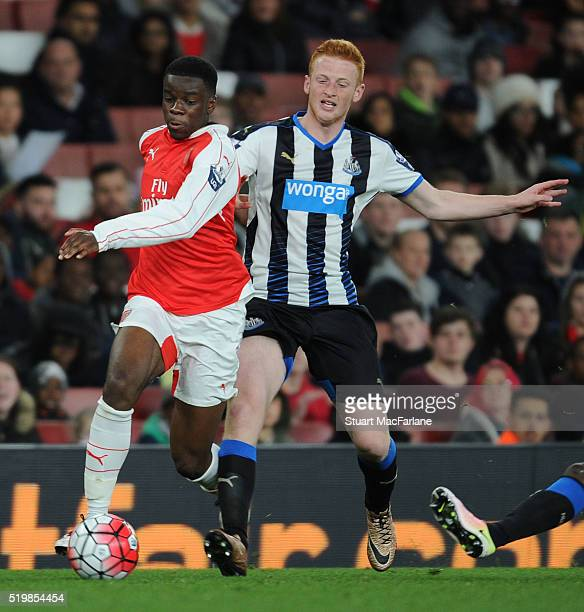 Stephy Mavididi of Arsenal breaks past Callum Williams of Newcastle during the Barclays Premier League match between Arsenal and Newcastle United at...