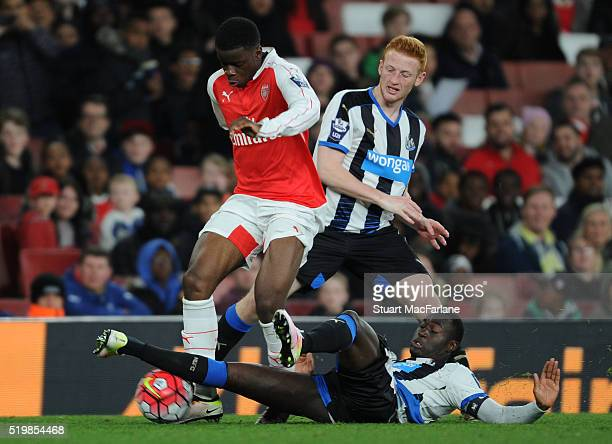Stephy Mavididi of Arsenal challenged by Callum Williams and Henri Saivet of Newcastle during the Barclays Premier League match between Arsenal and...