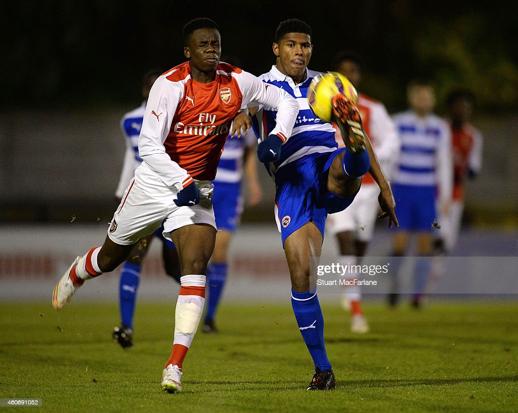 Stephy Mavididi of Arsenal challenges Zak Jules of Reading during the FA Youth Cup 3rd Round match between Arsenal and Reading at Meadow Park on December 19, 2014 in Borehamwood, England.