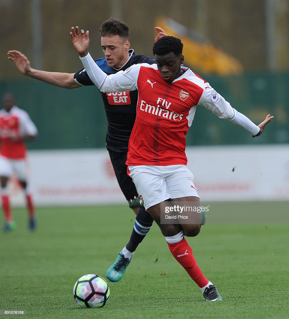 Stephy Mavididi of Arsenal is tripped by Alex Cover of Derby during the match between Arsenal U23 and Derby County U23 at London Colney on January 6, 2017 in St Albans, England.