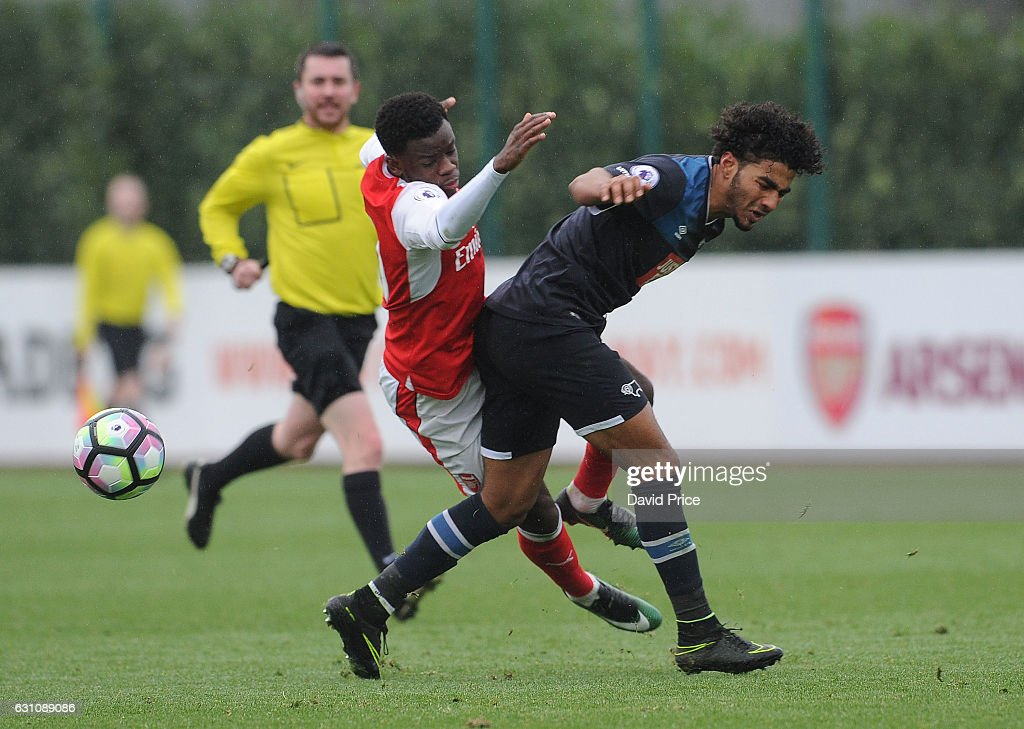 Stephy Mavididi of Arsenal is tripped by Josh Lelan of Derby during the match between Arsenal U23 and Derby County U23 at London Colney on January 6, 2017 in St Albans, England.