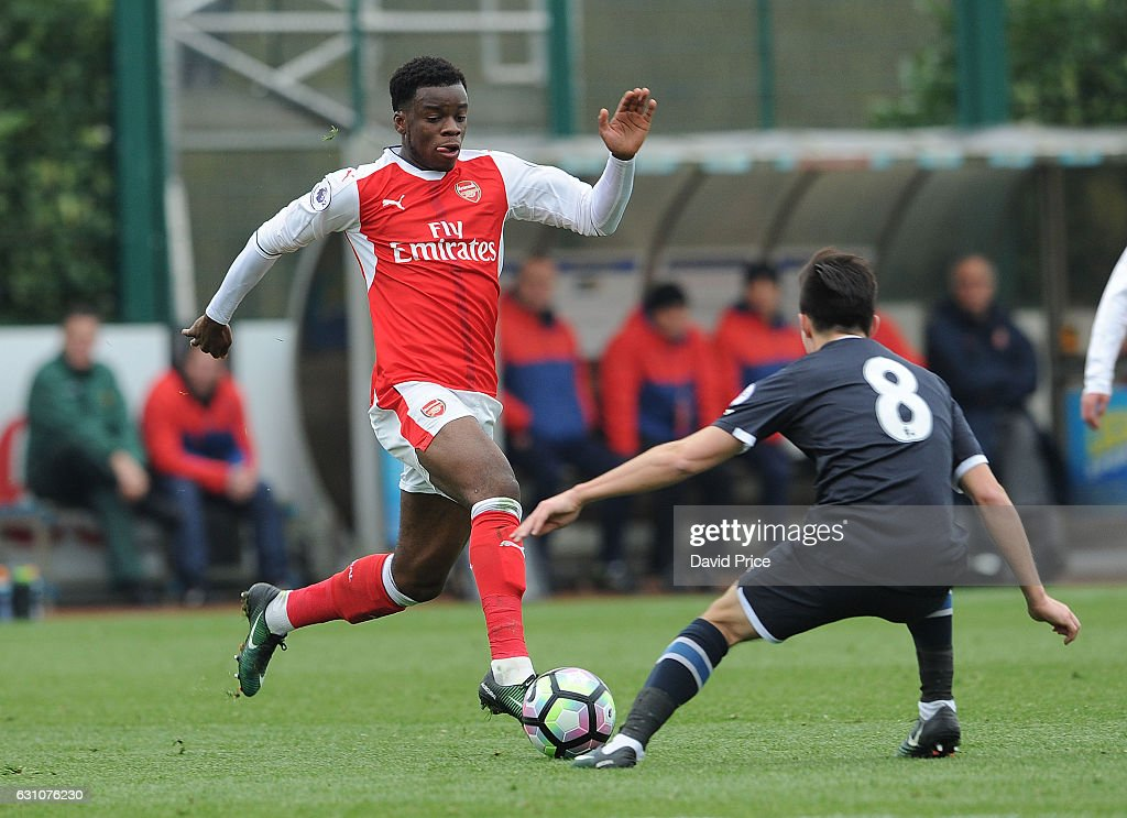 Stephy Mavididi of Arsenal takes on Alex Babos of Derby during the match between Arsenal U23 and Derby County U23 at London Colney on January 6, 2017 in St Albans, England.