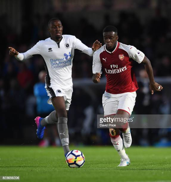 Stephy Mavididi of Arsenal takes on Frank Keita of Boreham Wood during the match between Boreham Wood and Arsenal XI at Meadow Park on July 27 2017...